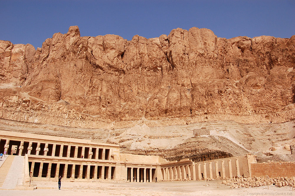 This is a photo of Deir el-Bahari against the cliffs.  This was the mortuary temple of Queen Hatshepsut of Dynasty 18.  The temple is located in West Thebes next door to the Middle Kingdom temple of Montuhotep.  When one visits Deir el-Bahari, one immediately notices the cliffs looming overhead.  I wanted to capture the magnitude of the cliffs compared to the temple.