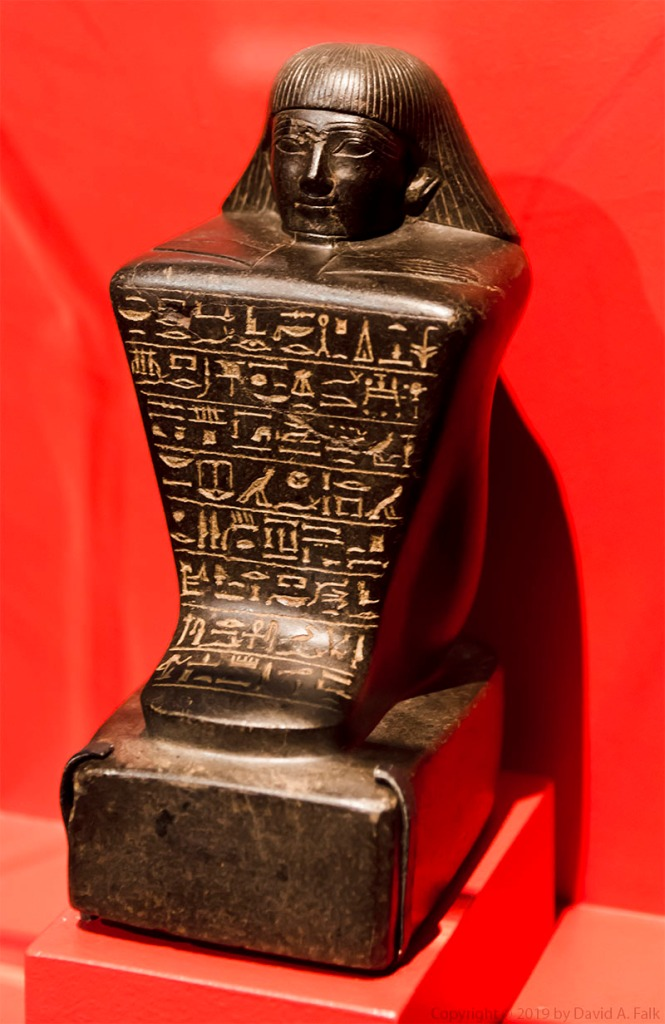 Here is a photo of the statue of Keret at the National Geographic Museum.  Keret was overseer of the royal herem.  He lived during the 18th Dynasty and the statue dates to Amenhotep II or Thutmosis IV.